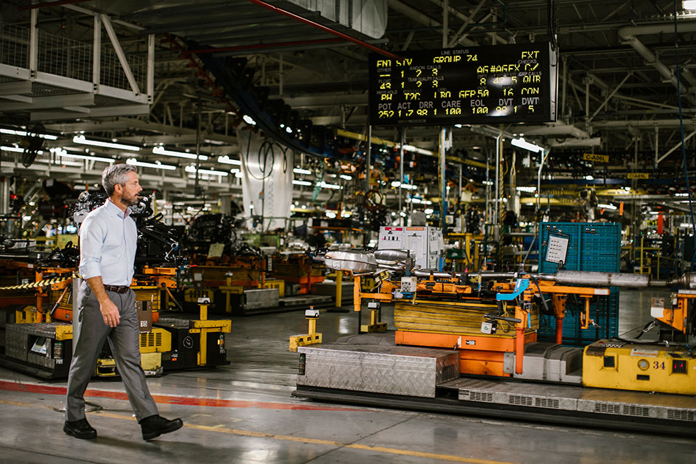 Man walking through General Motors Assembly Plant